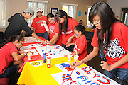 Native American students and their families make posters in support of the football team at the NASA Wildcat Family Pride Weekend before a game at the University of Arizona, Tucson, Arizona, USA.