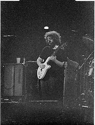 The Grateful Dead Performing Live in Concert at the Hartford Civic Center on 28 May 1977. Original film scan from Kodak CG negative stock, pushed 2 stops, processing by Berkey K&L Lab NYC. Photography by James R Anderson. B&W conversion of a very underexposed frame.