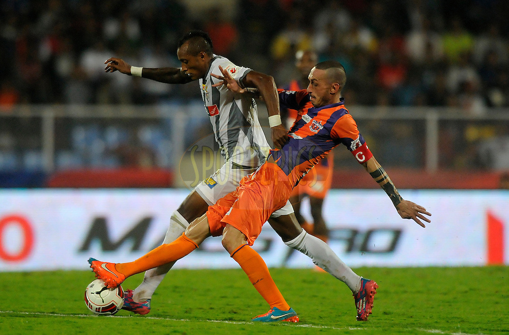 Fikru Tefera Lemessa of Atletico de Kolkata and Bruno Cirillo of FC Pune City during match 44 of the Hero Indian Super League between FC Pune City and Atletico de Kolkata FC held at the Shree Shiv Chhatrapati Sports Complex Stadium, Pune, India on the 29th November 2014.<br /> <br /> Photo by:  Pal Pillai/ ISL/ SPORTZPICS