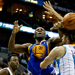 Jan 19, 2013; New Orleans, LA, USA; New Orleans Hornets center Robin Lopez (15) knocks the ball away from Golden State Warriors center Festus Ezeli (31) during  the second half of a game at the New Orleans Arena. The Warriors defeated the Hornets 116-112. Mandatory Credit: Derick E. Hingle-USA TODAY Sports