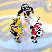Toledo's Christian Hilbrich (8), left, and Cincinnati's Mike Barrett (29), right, await the puck drop by referee Jeff Parker (22) at the beginning of an ECHL hockey game between the Toledo Walleye and Cincinnati Cyclones at the Huntington Center in Toledo on Sunday, January 28, 2018. THE BLADE/KURT STEISS