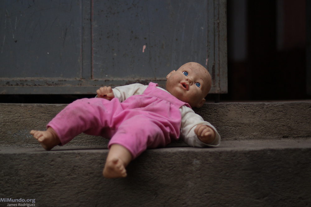 A doll lays at the home of Angela Camposeco, 49, Jakaltek Mayan coffee grower. Santiago Petatan, Concepción Huista, Huehuetenango, Guatemala. February 4, 2013.