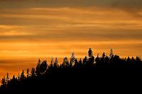 The setting sun illuminates the clouds over Rathdrum Mountain on Thursday, Oct. 14, 2010.