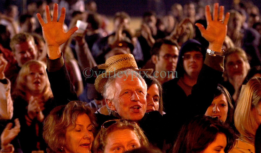 29 Oct, 2005.   New Orleans, Louisiana. Post Katrina.<br /> Let the good times roll. Voodoo Fest tribute concert at Riverview Park. Doc Price cheers Kermit Ruffins from the crowd.<br /> Photo; ©Charlie Varley/varleypix.com