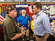 17 AUGUST 2019 - DES MOINES, IOWA: Representative SETH MOULTON (D-MA), right, talks to the Sargent at Arms for the Iowa Veterans of Foreign Wars at the Iowa State Fair Saturday.  Moulton, a US Marine veteran who served in Iraq, is running to be the Democratic candidate for the US Presidency in 2020 and spent Saturday campaigning at the fair. Iowa traditionally hosts the the first selection event of the presidential election cycle. The Iowa Caucuses will be on Feb. 3, 2020.         PHOTO BY JACK KURTZ