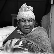 Andrea Castro Salas vda de Benavidez, 83, seller,  Potosi. Bolivia..Sitting at 4,090M (13,420 Feet) above sea level the small mining community of Potosi, Bolivia is one of the highest cities in the world by elevation and sits ?sky high? in the hills of the land locked nation. Overlooking the city is the infamous mountain, Cerro Rico (rich mountain), a mountain conceived to be made of silver ore. It was the major supplier of silver for the spanish empire and has been mined since 1546, according to records 45,000 tons of pure silver were mined from Cerro Rico between 1556 and 1783, 9000 tons of which went to the Spanish Monarchy. The mountain produced fabulous wealth and became one of the largest and wealthiest cities in Latin America. The Extraordinary riches of Potosi were featured in Maguel de Cervantes famous novel Don Quixote. One theory holds that the mint mark of Potosi, the letters PTSI superimposed on one another is the origin of the dollar sign. Today mainly zinc, lead, tin and small quantities of silver are extracted from the mine by over 100 co-operatives and private mining companies who still mine the mountain in poor working conditions, children are still used in the mines and the lack of protective equipment and constant inhalation of dust means miners have a short life expectancy with many contracting silicosis and dying around 40 years of age. UNESCO designated the historic city a World Heritage site in 1987. Most of Potosí's colonial churches have been restored, and tourism has increased. Potosi, Bolivia. 16th September 2011. Photo Tim Clayton