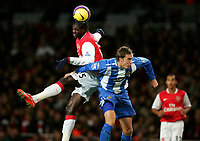 Photo: Tom Dulat/Sportsbeat Images.<br /> <br /> Arsenal v Wigan Athletic. The FA Barclays Premiership. 24/11/2007.<br /> <br /> Andreas Granqvist of Wigan Athletic and Emmanuel Adebayor of Arsenal head for the ball.
