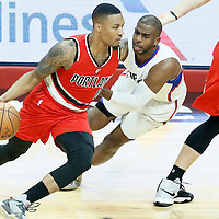 09 November 2016: Portland Trail Blazers guard Damian Lillard (0) drives past Los Angeles Clippers guard Chris Paul (3) during the LA Clippers 111-80 victory over the Portland Trail Blazers, at the Staples Center, Los Angeles, California, USA.
