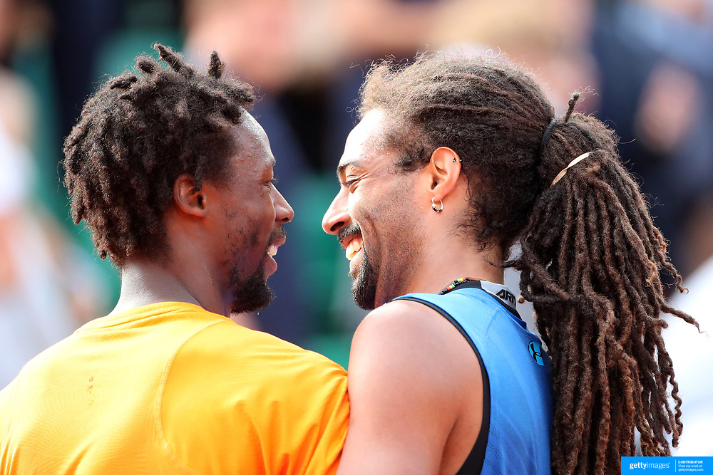 2017 French Open Tennis Tournament - Day Three.  Dustin Brown of Germany congratulates Gael Monfils of France on his victory as they embrace at the end of the match on Suzanne-Lenglen Court during the Men's Singles round one match at the 2017 French Open Tennis Tournament at Roland Garros on May 30th, 2017 in Paris, France.  (Photo by Tim Clayton/Corbis via Getty Images)