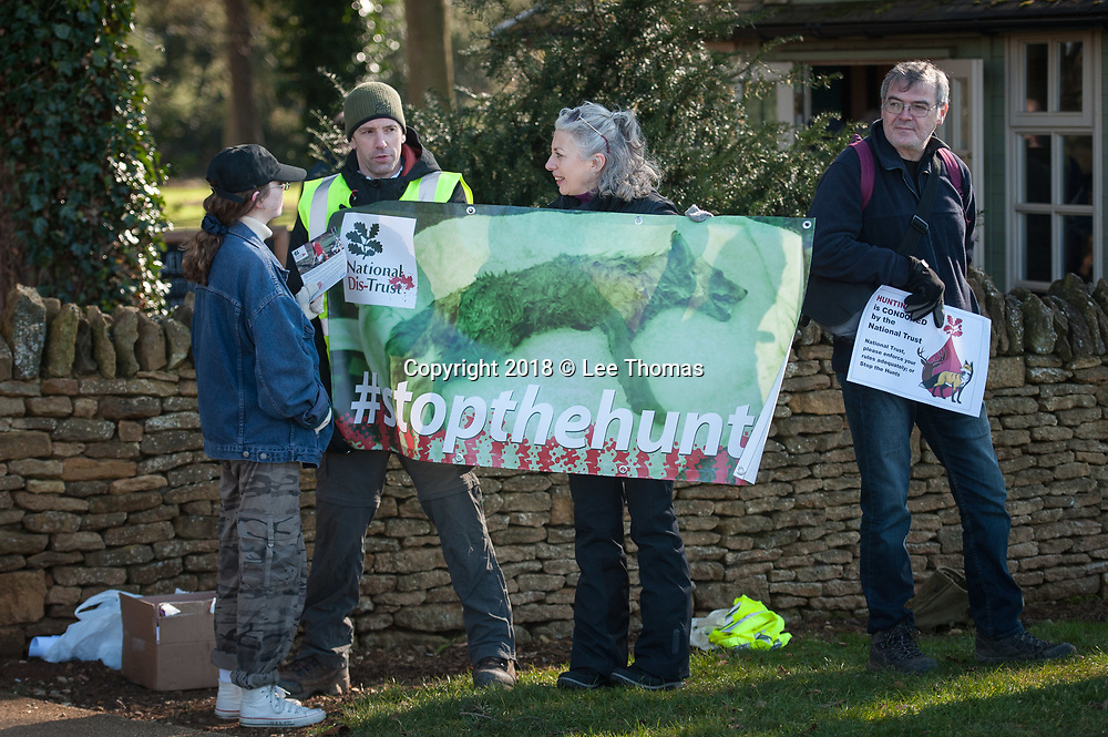 Upton House, Banbury, Oxfordshire, UK. 25th February 2018.  Protesters take part in a demonstration outside Upton House & Gardens NT in Oxfordshire. The demonstration is one of several protests being held today by National Dis-Trust, a  campaign group against hunting on National Trust land. At present, the National Trust allows so-called 'trail hunts' on its land, where hounds are 'supposedly' following a scent but National Dis-Trust supporters claim many wild animals, including foxes, hares and deer, end up being chased and killed at these events.  // Lee Thomas, Tel. 07784142973. Email: leepthomas@gmail.com  www.leept.co.uk (0000635435)