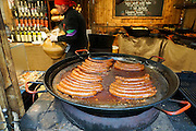 Budapest, Hungary sausages cooking at a food stall in the central market
