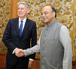 April 4, 2017 - New Delhi, India - British Chancellor of Exchequer, Philip Hammond, left, shakes hands with Indian Finance Minister Arun Jaitley prior to a bilateral meeting April 4, 2017 in New Delhi, India. (Credit Image: © Naveen Katyal/Planet Pix via ZUMA Wire)