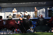 Audience enjoys performance by band on a summer evening in Jefferson Barracks Park during one of many Food Truck Fest events sponsored by St. Louis County Parks throughout summer; St. Louis, MO