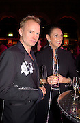 Sting and Gail Ronson<br />Fundraising party with airline theme in aid of the Old Vic and to celebrate the appointment of Kevin Spacey as artistic director.  <br />Old Billinsgate Market.  5 February 2003. © Copyright Photograph by Dafydd Jones 66 Stockwell Park Rd. London SW9 0DA Tel 020 7733 0108 www.dafjones.com
