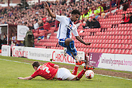 Rico Henry of Walsall is tackled by Josh Scowen of Barnsley during the Sky Bet League 1 Playoff Semi Final First Leg at Oakwell, Barnsley<br /> Picture by Matt Wilkinson/Focus Images Ltd 07814 960751<br /> 14/05/2016