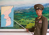 Colonel showing a map of the Wall, Dmz, Panmunjom, North Korea.
