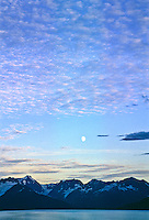 Moon and sunset over Turnagain Arm and the Kenai Peninsula.  Alaska.