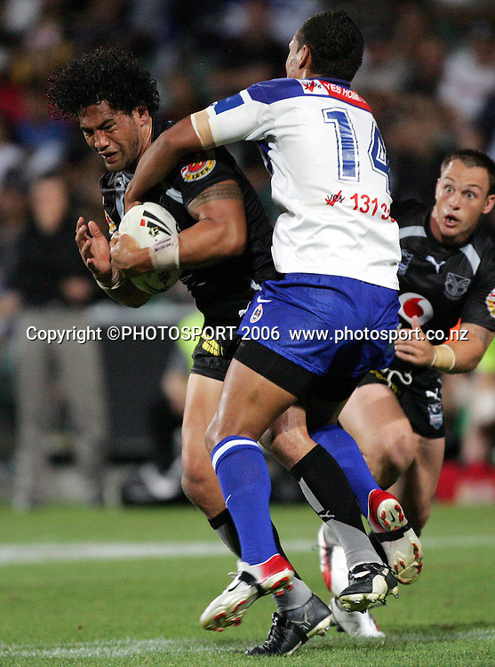 Warriors prop Ruben Wiki is tackled by Lee Te Maari at the pre season NRL match between the Warriors and Bulldogs at North Harbour Stadium, Auckland, New Zealand, on Saturday 3 March 2007. Photo: Andrew Cornaga/PHOTOSPORT