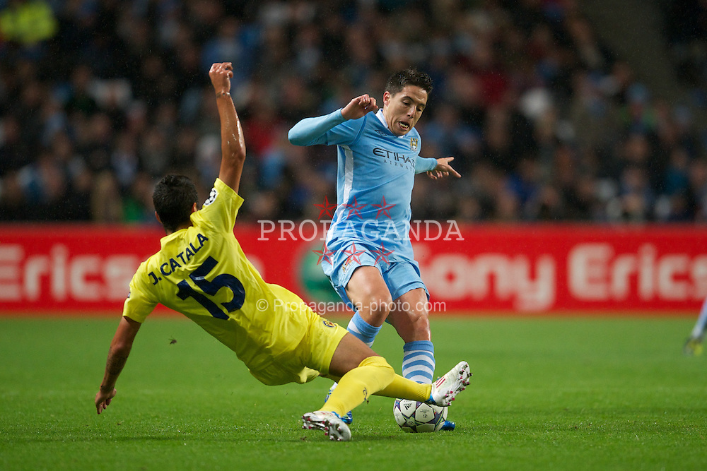 MANCHESTER, ENGLAND - Tuesday, Octover 18, 2011: Manchester City's Samir Nasri in action against Villarreal CF's Jose Catala during the UEFA Champions League Group A match at the City of Manchester Stadium. (Pic by David Rawcliffe/Propaganda)