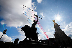 © Licensed to London News Pictures. 18/06/2020. London, UK.The Red Arrows and La Patrouille de France fly over the bronze figure 'Progress' at the Victoria Memorial outside Buckingham Palace. The flypast followed London being awarded the Legion d'honneur by President Macron for its support to the people of France during the Second World War. Photo credit: Steve Duncombe/LNP