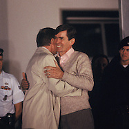 Bruce Laingen embraces former president Jimmy Carter at the end of the of the Iran hostages.  Hostages had be released and flown to Ramstein Air Base in Germany.<br /> Photo by Dennis Brack