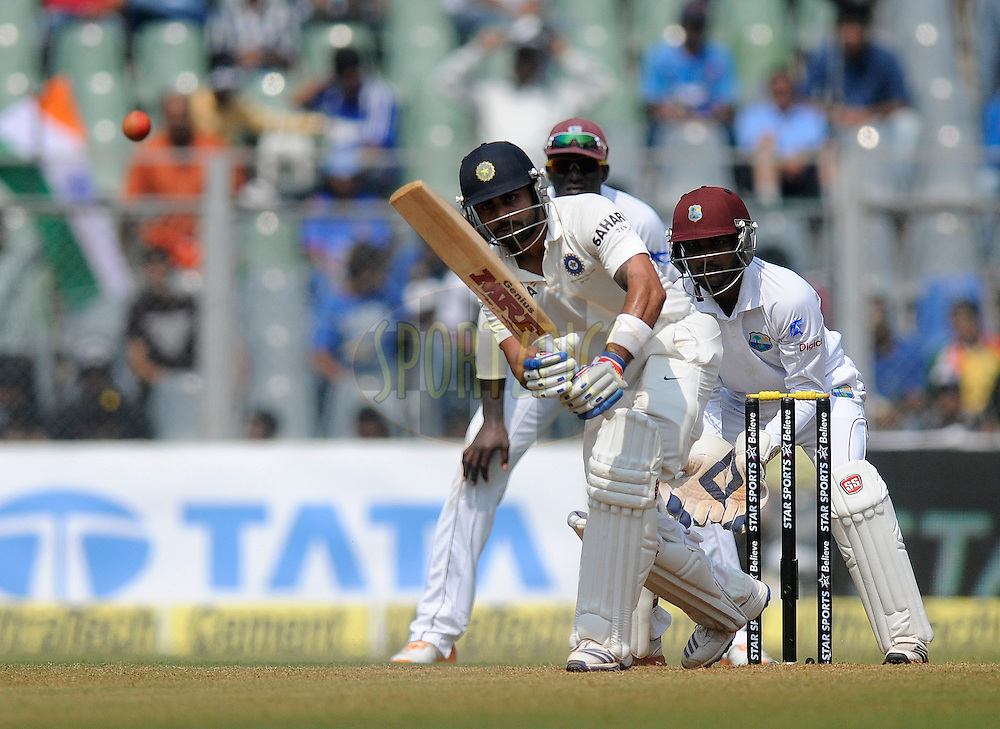 Virat Kholi of India bats during day two of the second Star Sports test match between India and The West Indies held at The Wankhede Stadium in Mumbai, India on the 15th November 2013<br /> <br /> This test match is the 200th test match for Sachin Tendulkar and his last for India.  After a career spanning more than 24yrs Sachin is retiring from cricket and this test match is his last appearance on the field of play.<br /> <br /> <br /> Photo by: Pal PIllai - BCCI - SPORTZPICS<br /> <br /> Use of this image is subject to the terms and conditions as outlined by the BCCI. These terms can be found by following this link:<br /> <br /> http://sportzpics.photoshelter.com/gallery/BCCI-Image-Terms/G0000ahUVIIEBQ84/C0000whs75.ajndY