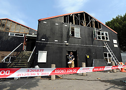 © licensed to London News Pictures. MARLOW, UK.  03/08/11. Marlow Rowing Club has been badly damaged by fire today (03 August 2011). Boats with an estimated value of 100,000 pounds have been damaged. Steve Redgrave, Olympic Rower, who trained at the club and is from Marlow said his daughters boat is believed to be inside.  Mandatory Credit Stephen Simpson/LNP
