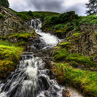 The majestic power of a long exposure shot of a waterfall in the lake district with water crashing over the rocks