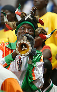 Ivory coast fan blowing horng.. Ivory Coast V Mali. African Cup of Nations 2008. Ohene Djan stadium. Accra. Ghana. West Africa..©Picture Zute Lightfoot.  07939 108077. www.lightfootphoto.co.uk