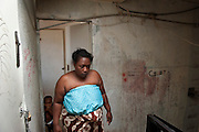 Fatima, poor habitant in front of her appartment in a flat in Kalliste, one of the poorest districs in the city of Marseilles, used as a base for drug trafficking on a large scale, leading to murders among groups of competing dealers. 19 people were shot dead in drugs related killings in 2012, mainly with Kalachnikovs...Fatima devant la porte de son appartement dans la cité Kalliste, à Marseille. Kalliste est une des cités les plus pauvres dans la ville, utilisée comme une base pour le trafic de drogue à grande échelle, conduisant à des reglements de compte par des groupes de dealers concurrents.....Fatima voor haar flat in de wijk Kalliste, Marseille. Kalliste in één van de armste flatwijken in de stad, en wordt gebruikt als basis voor grootschalige drugshandel.