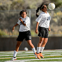 100114  Adron Gardner/Independent<br /> <br /> Navajo Prep Eagle Yvetta Gorman (16) lines up a header during a match against the Holbrook Roadrunners at the Gallup Sports Complex Wednesday.