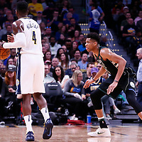 01 April 2018: Milwaukee Bucks forward Giannis Antetokounmpo (34) defends on Denver Nuggets forward Paul Millsap (4) during the Denver Nuggets 128-125 victory over the Milwaukee Bucks, at the Pepsi Center, Denver, Colorado, USA.