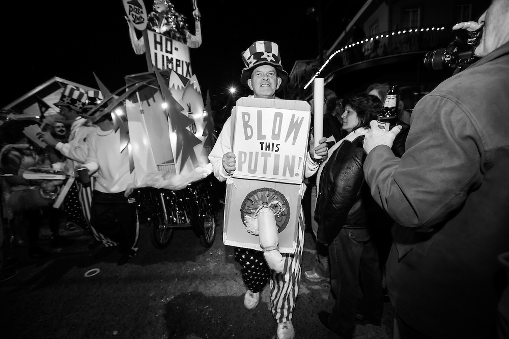 """Feb 15,  New Orleans, LA, Man with a fake penis mocking Putin in the Krewe du Vieux Mardi Gras parade that roles through New Orleans Marigny and French Quarter.he 2014  theme was """"Where the Vile Things Are,"""".  Krewe du Vieux is know for it  raucous irreverent satire displayed on the floats and by the Krewe members."""