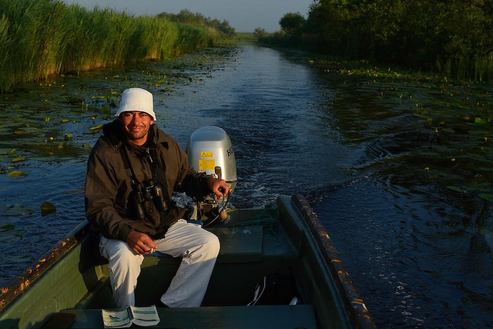 Boat guide and pension owner Florin Oprisan, tourism, Danube delta rewilding area, Romania