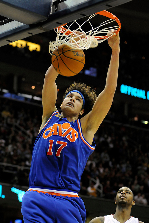 Feb 4, 2010; Cleveland, OH, USA; Cleveland Cavaliers forward Anderson Varejao (17) dunks during the fourth quarter against the Miami Heat at Quicken Loans Arena. The Cavaliers beat the Heat 102-86. Mandatory Credit: Jason Miller-US PRESSWIRE