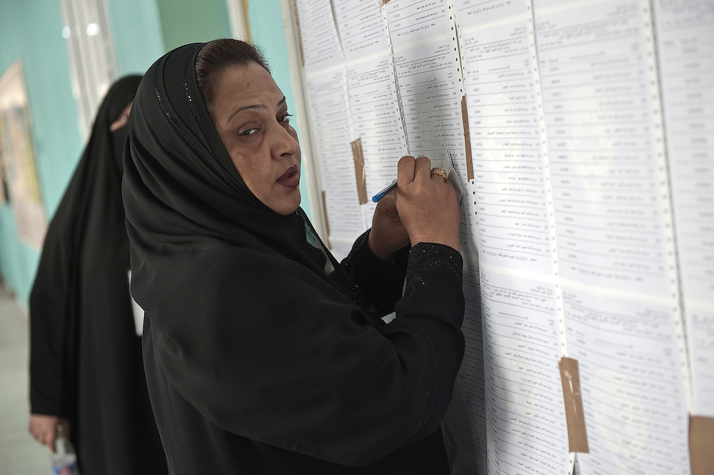 Kuwaiti women voter searches for her name at a polling station in Kuwait City ahead of voting in the February 2 parliamentary elections. A total of 400,296 Kuwaiti men and women are eligible to vote to choose from among some 285 candidates, including more than 20 women candidates, for a new 50-seat parliament.