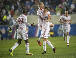 March 1, 2018 - Harrison, New Jersey, United States - New York Red Bulls defender MARC RZATKOWSKI (90) and New York Red Bulls forward BRADLEY WRIGHT-PHILLIPS (99) celebrate the goal by New York Red Bulls midfielder SEAN DAVIS (27) during the CONCACAF Champions league match at Red Bull Arena in Harrison, NJ.  NY Red Bulls defeat CD Olimpia 2-0  (Credit Image: © Mark Smith via ZUMA Wire)