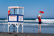 Lifeguard waving swimmers to shore, Ocean City, New Jersey, USA