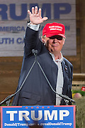 Billionaire and GOP presidential candidate Donald Trump waves after addresses supporters at a rally January 27, 2016 in Lexington, South Carolina.