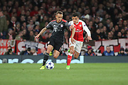 Arsenal attacker Alexis Sanchez (7) battles for possession with Bayern Munich defender Rafinha (13) during the Champions League round of 16, game 2 match between Arsenal and Bayern Munich at the Emirates Stadium, London, England on 7 March 2017. Photo by Matthew Redman.