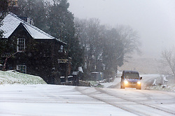 © Licensed to London News Pictures. 22/01/2019. Snowdonia, Gwynedd, Wales, UK.  A motorist drives towards Pen-Y-Pas as snow showers continue in Snowdonia National Park, Gwynedd, UK. credit: Graham M. Lawrence/LNP