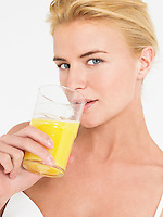 Young Woman in underwear Drinking Orange Juice portrait