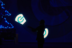 © Licensed to London News Pictures.  30/11/2012. LONDON, UK. A perform spins light wands creating the shows logo during the Gadget Show Live event at the ExCel centre in London, The technology event opened today (Friday 30th) and runs until Sunday. Photo credit :  Cliff Hide/LNP