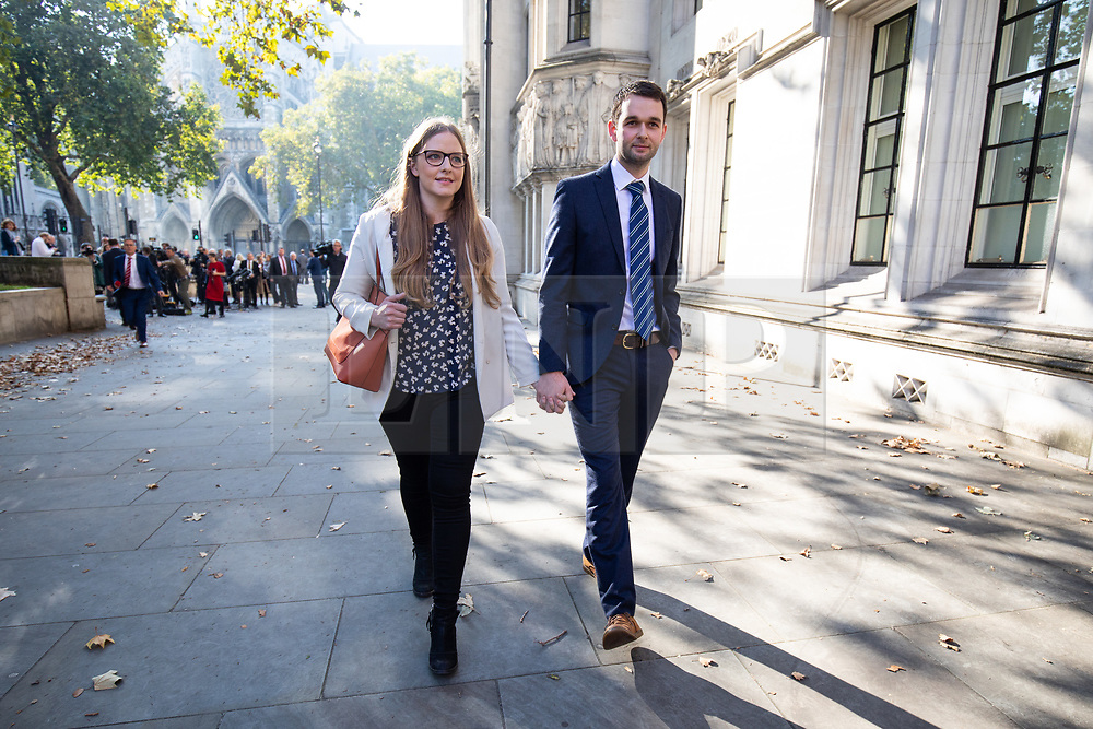 """© Licensed to London News Pictures. 10/10/2018. London, UK. Daniel and Amy McArthur, owners of Ashers Bakery in Belfast, leave The Supreme Court. Today the Supreme Court ruled that they did not discriminate against a customer by refusing to decorate a cake with the slogan """"Support Gay Marriage"""". The case has become known as the 'gay cake' case. Photo credit : Tom Nicholson/LNP"""