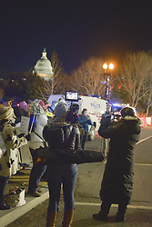 January 30, 2018 - Washington Dc, DC, U.S - Washington Dc, Jan 30, 2018 - Activists run a protest evening Tuesday, State of the Union events against President Donald Trump's speech. .Civil rights advocates from the NAACP and the women leading the ''MeToo'' movement are among those who will hold events to counter the State of the Union address. While the president is set to begin speaking at 9 p.m., the groups set out their agendas for the new year, including laying out how to combat the Trump administration, based on the press release. .Derrick Johnson, the NAACP president, and CEO said in a statement that rather than listen to a ''racist nationalist agenda,'' the group would discuss ''protecting the vote and mobilizing for midterm elections.'' The protester was standing at 3th street and independent Blvd, in Washington, D.C., at since 7:30 p.m. (Credit Image: © Ardavan Roozbeh via ZUMA Wire)