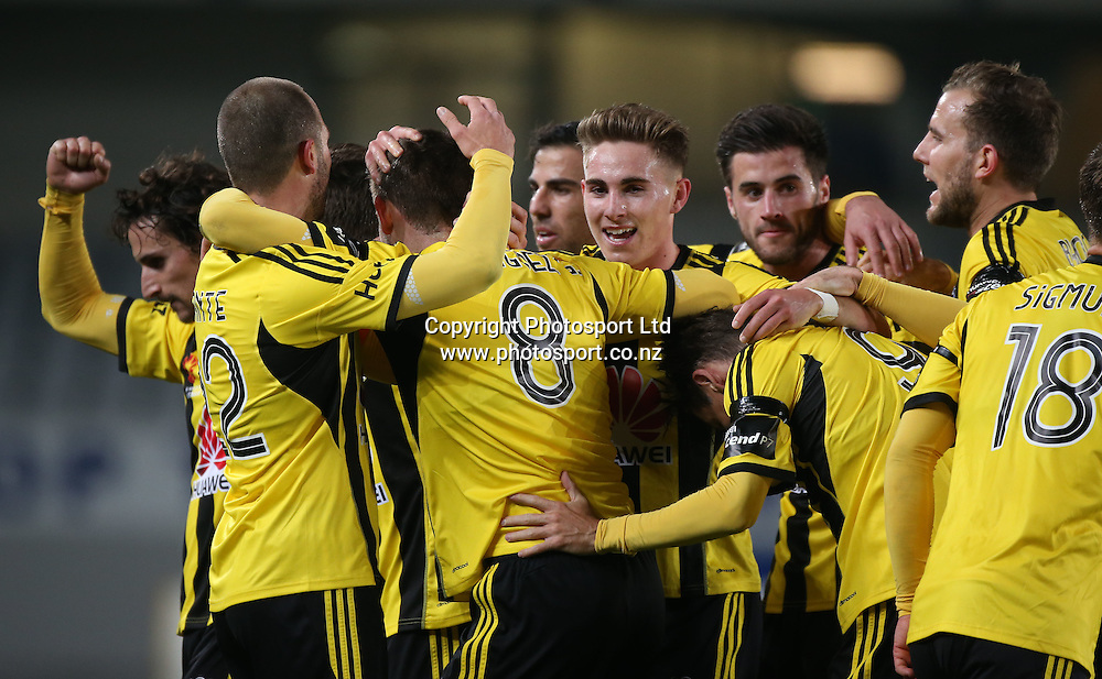 Alejandro Rodriguez of the Wellington Phoenix, 8, celebrates with team mates including fellow goal scorer Andrew Durante, left, after his goal during the Wellington Phoenix vs West Ham United football match played at Eden Park in Auckland on 23 July 2014. <br /> Credit; Peter Meecham/ www.photosport.co.nz