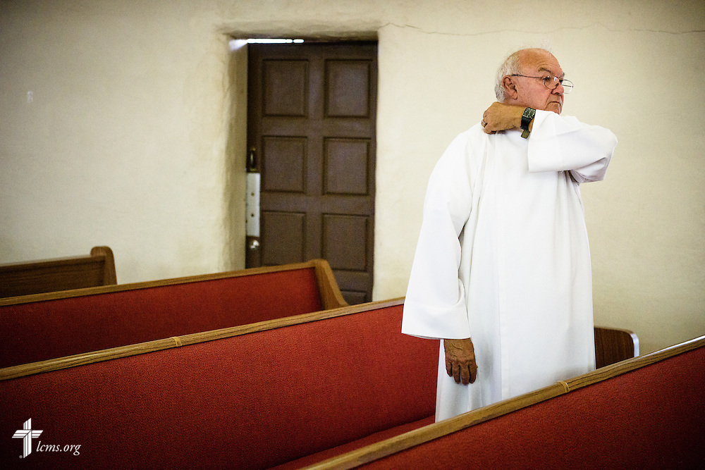 The Rev. Karl Heimer, pastor of San Pablo Lutheran Church and president of Ysleta Lutheran Mission Human Care, prepares to baptize new Cuban immigrants following catechism on Friday, May 20, 2016, at the church on the campus of Ysleta Lutheran Mission Human Care in El Paso, Texas. LCMS Communications/Erik M. Lunsford