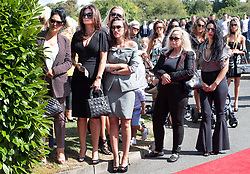 © Licensed to London News Pictures. 21/08/2018. Epsom, UK. Mourners attend the funeral of traveller Mikey Connors in Epsom cemetery. 32 year-old Mikey Connors, the nephew of My Big Fat Gypsy Wedding star Paddy Doherty, was killed when his horse-and-cart was hit by a car in Thamesmead on July 28. Photo credit: Peter Macdiarmid/LNP