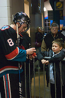 KELOWNA, CANADA, DECEMBER 3: Colten Martin #8 of the Kelowna Rockets signs an autograph for a fan as the Prince George Cougars visit the Kelowna Rockets  on December 3, 2011 at Prospera Place in Kelowna, British Columbia, Canada (Photo by Marissa Baecker/Shoot the Breeze) *** Local Caption ***