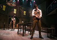 "Marshall Taylor Thurman as Ransome Foster loads his gun as Nicholas Wilder as Liberty Valance walks into the saloon during Tuesday's dress rehearsal for ""The Man Who Shot Liberty Valance"" at the Winnipesaukee Playhouse.  (Karen Bobotas/for the Laconia Daily Sun)"